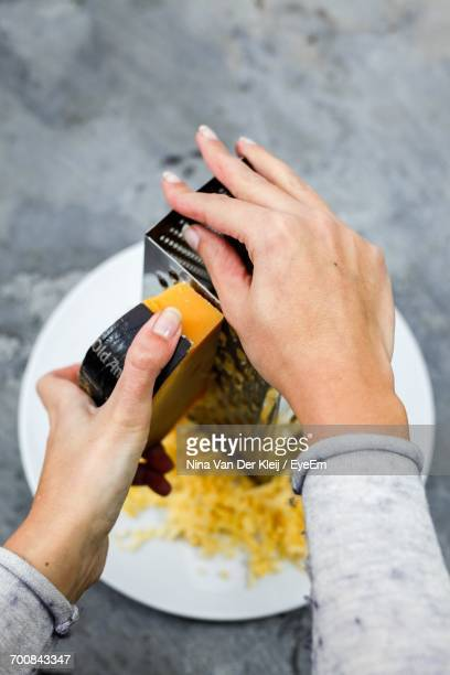 Close-Up Of Woman Grating The Cheese