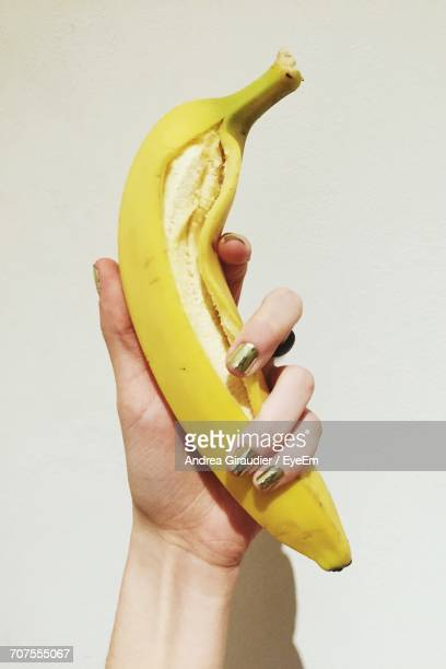 Close-Up Of Woman Hand Holding Fruit