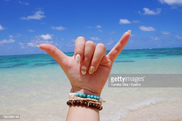 Close-Up Of Woman Hand On Beach