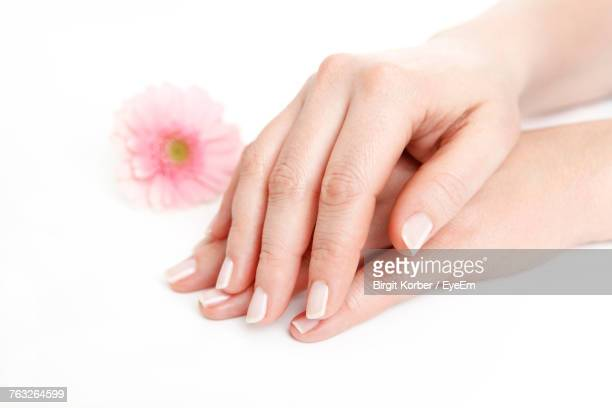 Close-Up Of Woman Hand On Table