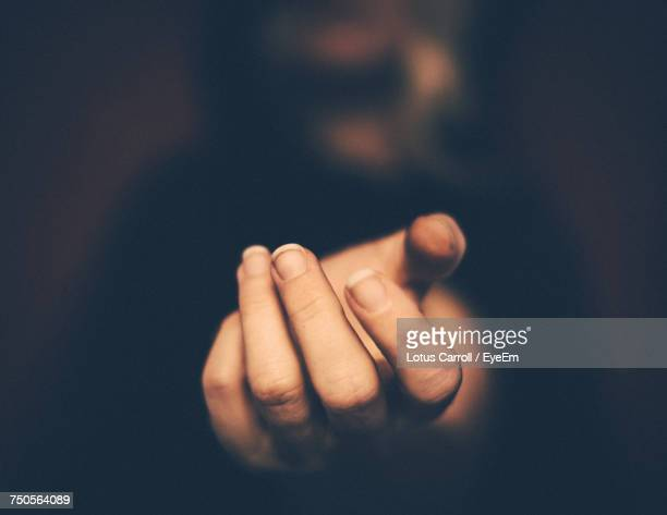 close-up of woman hand over black background - reaching stock pictures, royalty-free photos & images