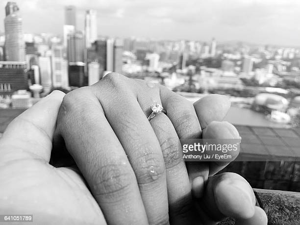 Close-Up Of Woman Hand With Engagement Ring