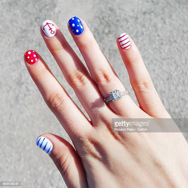 Close-Up Of Woman Hand With Nail Art