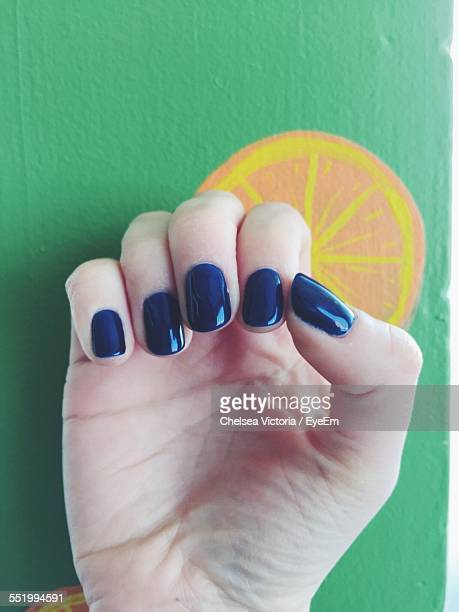 Close-Up Of Woman Hand With Painted Nails
