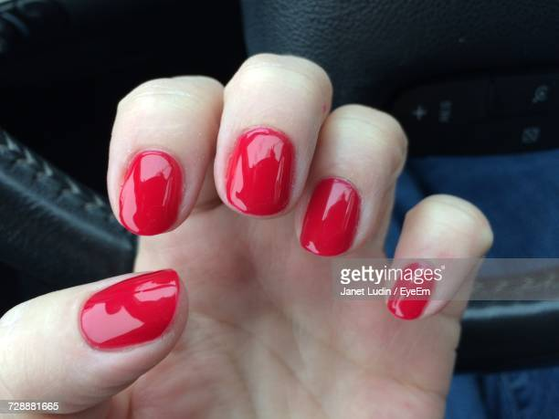 Close-Up Of Woman Hand With Red Nails
