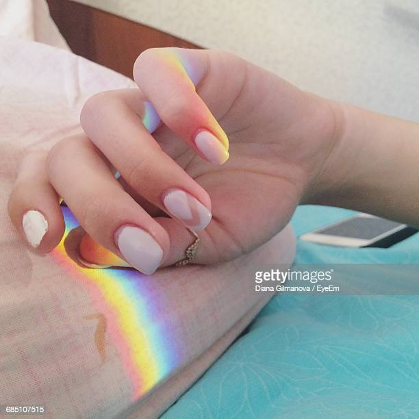 close-up of woman hand with spectrum on pillow - nail art stock pictures, royalty-free photos & images