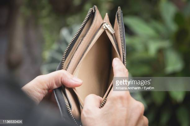 close-up of woman hands holding empty purse - clutch bag stock pictures, royalty-free photos & images