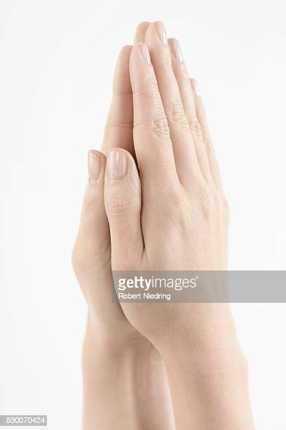Close-up of woman hands together symbolizing prayer and gratitude, Bavaria, Germany