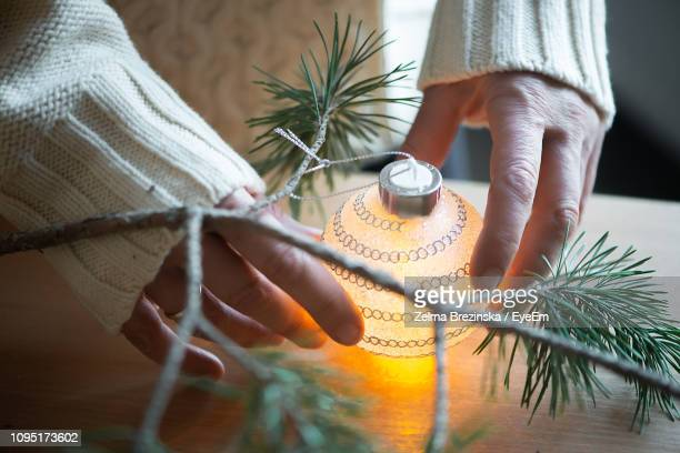 Close-Up Of Woman Holding Bauble