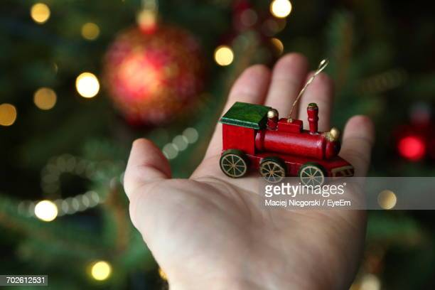 Close-Up Of Woman Holding Christmas Decoration
