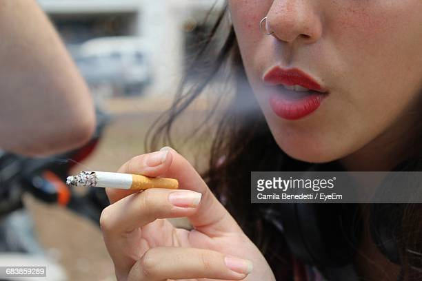 Close-Up Of Woman Holding Cigarette
