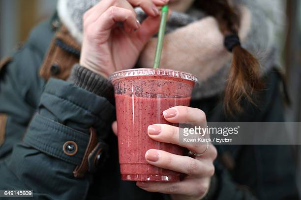 close-up of woman holding disposable cup with drink - drinking straw stock pictures, royalty-free photos & images