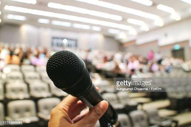 close-up of woman holding microphone - aungsumol stock pictures, royalty-free photos & images