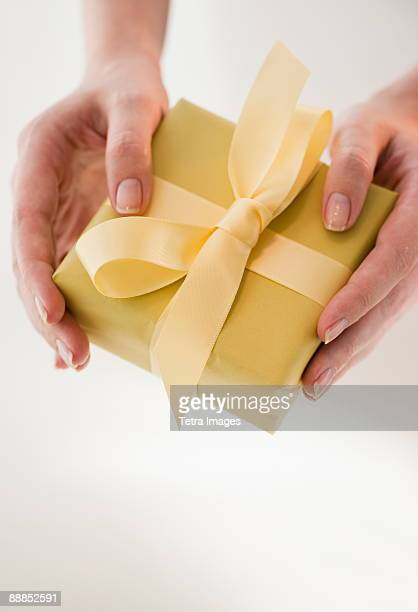 Close-up of woman holding present