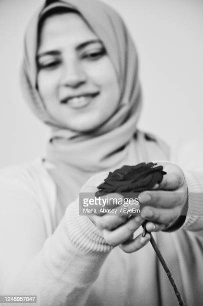close-up of woman holding rose flower - alexandria stock pictures, royalty-free photos & images