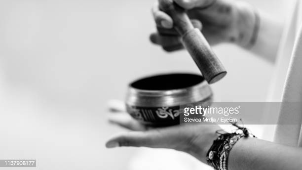close-up of woman holding singing bowl - gong stock pictures, royalty-free photos & images