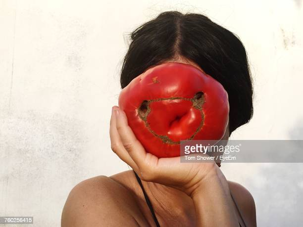 close-up of woman holding tomato - big tom stock pictures, royalty-free photos & images