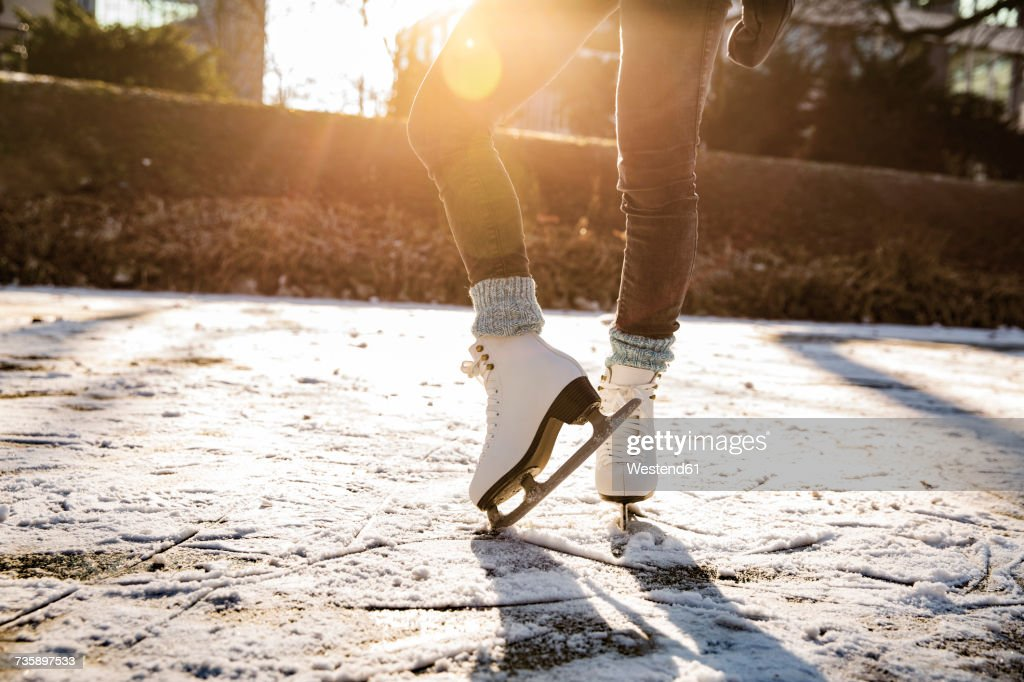 Close-up of woman ice skating on canal : Stockfoto