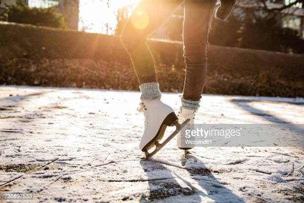 Close-up of woman ice skating on canal