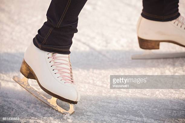 close-up of woman ice skating - ice rink stock photos and pictures