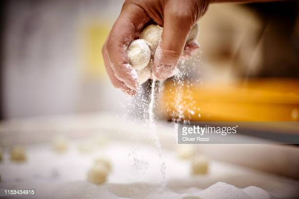 close-up of woman in a chocolate manufacture making pralines - sugar food stock pictures, royalty-free photos & images
