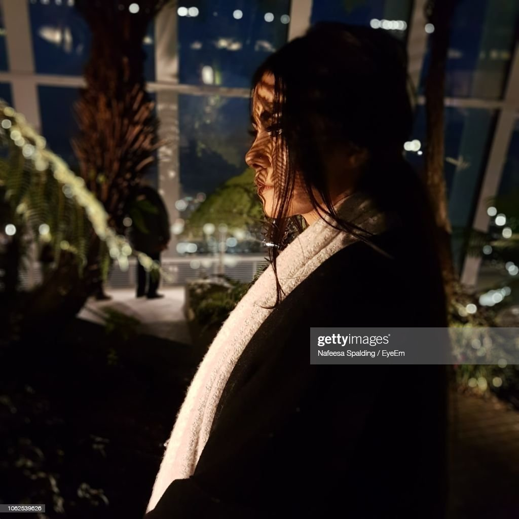 Close-Up Of Woman In City At Night : Stock Photo