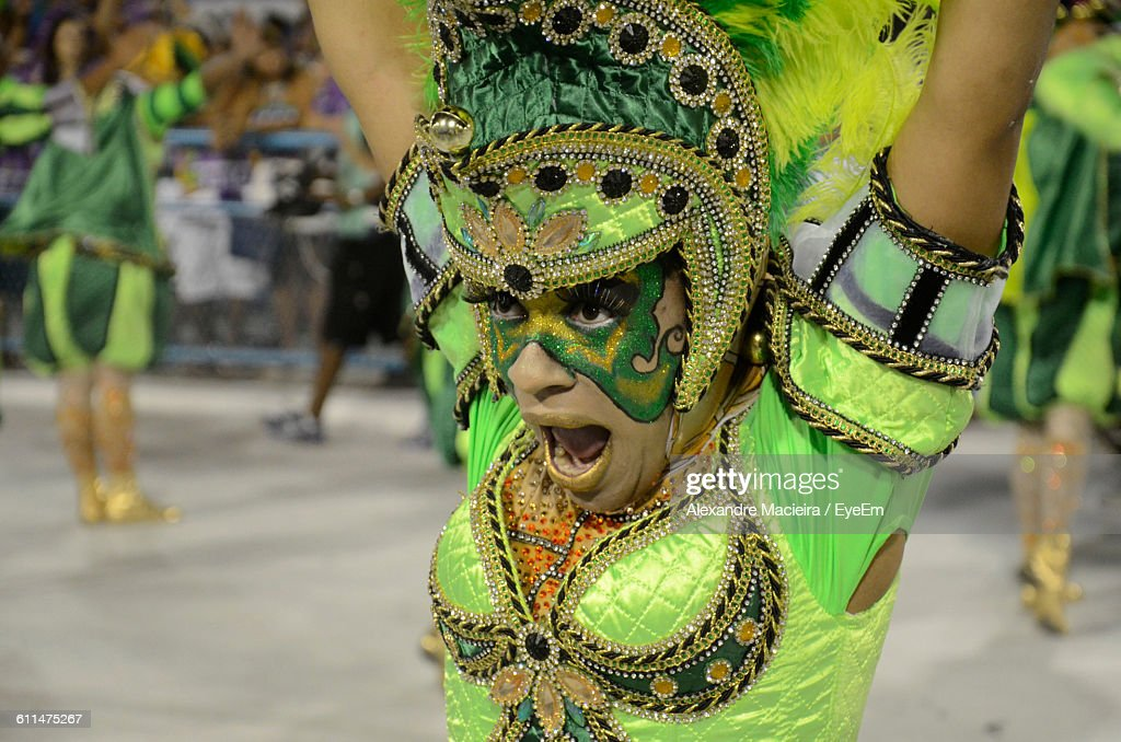 Close-Up Of Woman In Costume Dancing At Carnival : Stock Photo