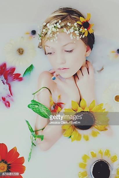 Close-Up Of Woman In Milk Bath With Flowers