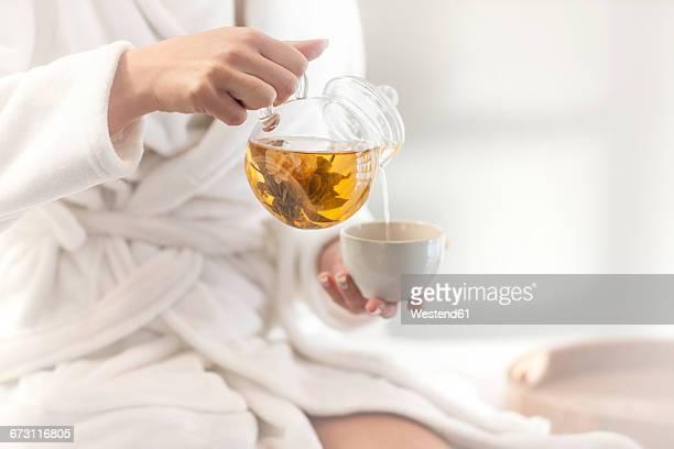 close-up of woman in spa having tea - chá bebida quente imagens e fotografias de stock