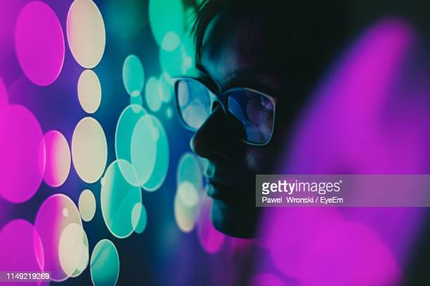 close-up of woman in sunglasses by neon lights - illuminated stock pictures, royalty-free photos & images