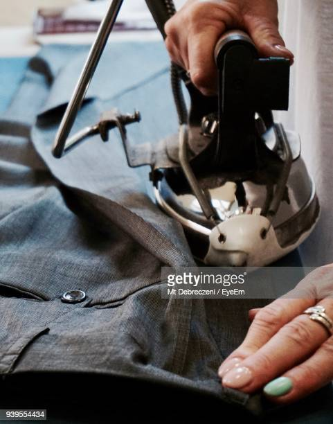 close-up of woman ironing pants at table - hands in her pants stock pictures, royalty-free photos & images