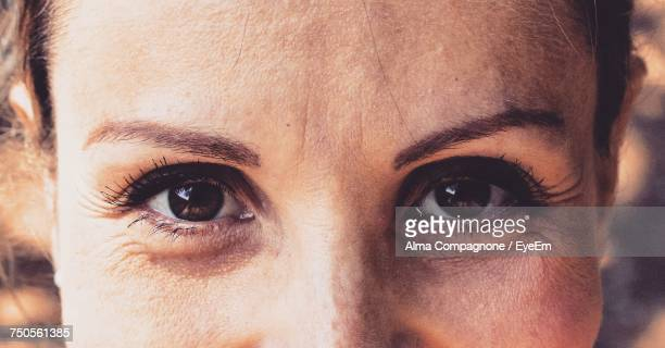 close-up of woman looking at camera - close up stock pictures, royalty-free photos & images