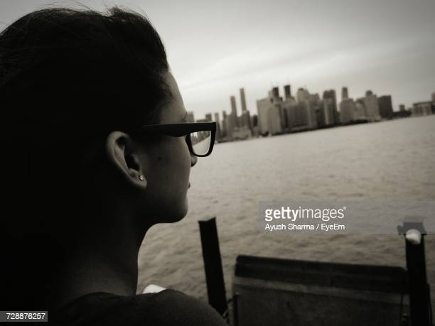 Close-Up Of Woman Looking At Lake In City