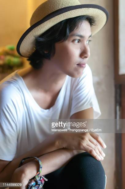 close-up of woman looking away - chanthaburi stock pictures, royalty-free photos & images