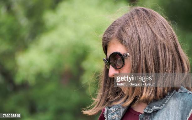 Close-Up Of Woman Looking Down While Wearing Sunglasses
