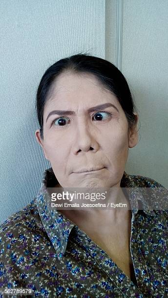 Close-Up Of Woman Making A Face At Home
