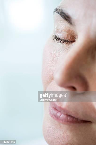 Close-up of woman napping