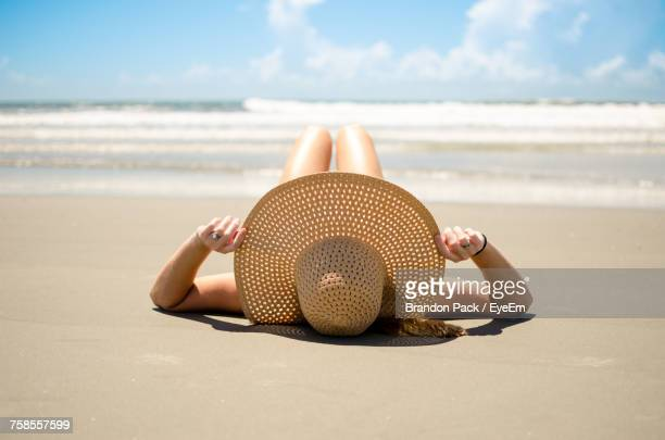 Close-Up Of Woman On Beach Against Sky