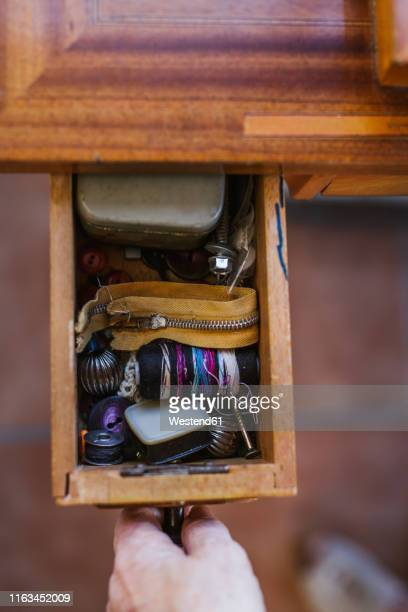 close-up of woman opening a drawer with sewing items - drawer stock pictures, royalty-free photos & images