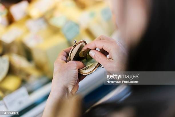 Close-up of woman paying at Market Stall