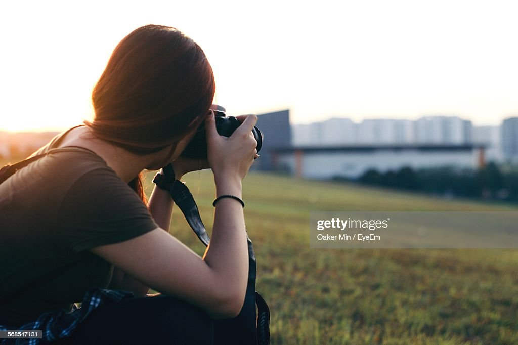Close-Up Of Woman Photographing On Field : Foto de stock