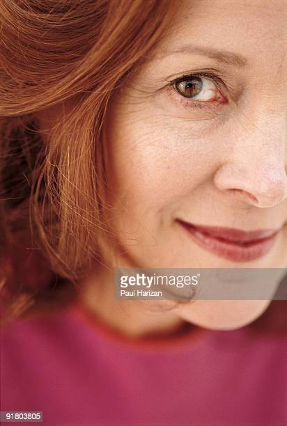 close-up of woman - one mature woman only stock-fotos und bilder