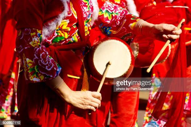 close-up of woman playing chinese waist drums - drum percussion instrument stock pictures, royalty-free photos & images