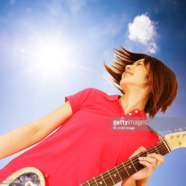 Close-up Of Woman Playing Guitar