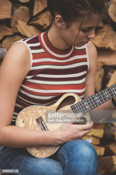close-up of woman playing guitar - kerry estey keith stock photos and pictures