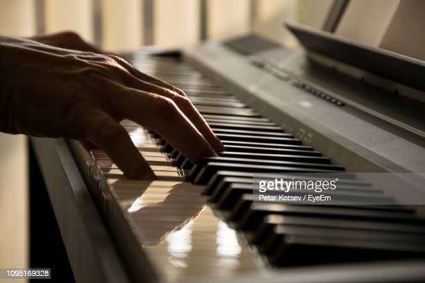 close-up of woman playing piano - keyboard instrument stock photos and pictures