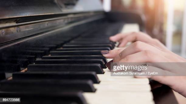 close-up of woman playing piano - keyboard player stock photos and pictures