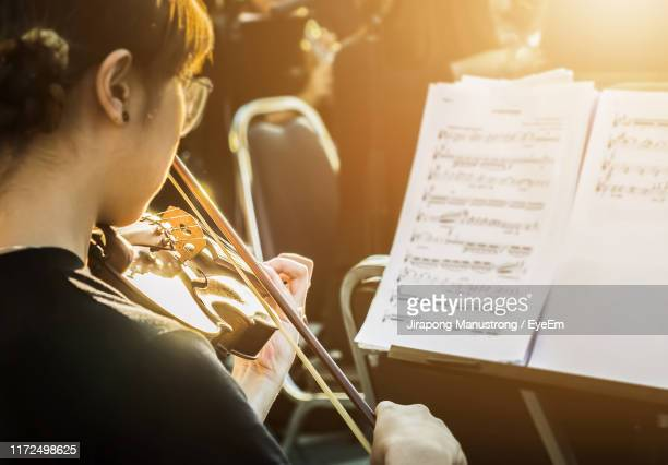close-up of woman playing violin - classical musician stock pictures, royalty-free photos & images