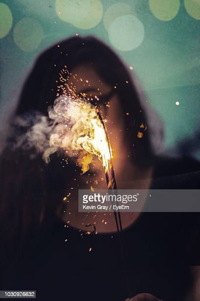 Close-Up Of Woman Playing With Sparklers