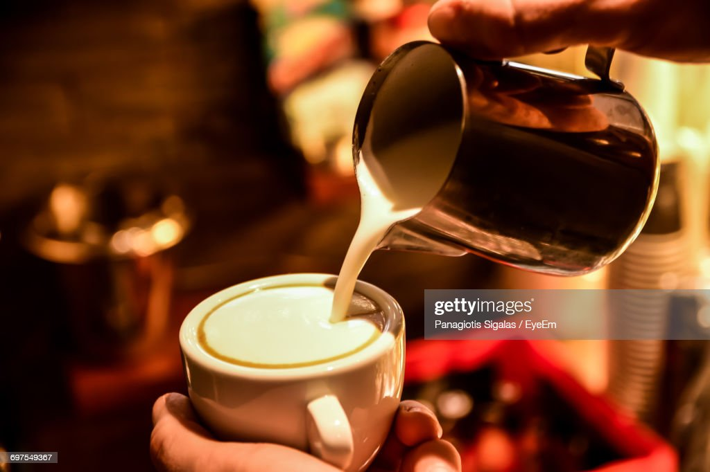 Close-Up Of Woman Pouring Coffee In Cup : Stock Photo